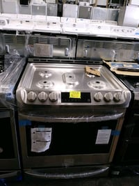 Brand new scratch and dent slide gas stove 5 burners