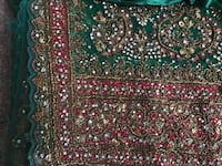Red, green heavily embroidered Sari with adjustable size 12 blouse and petticoat.