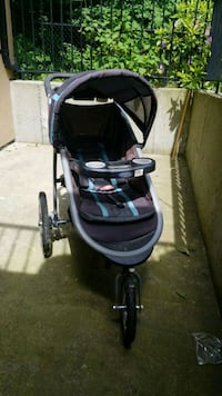 baby's black and gray jogging stroller Surrey, V3S 9C3