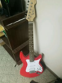 red and white stratocaster electric guitar 1058 mi