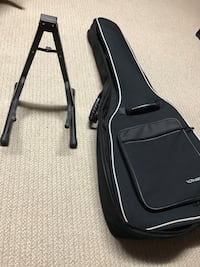 Guitar stand and acoustic bag.