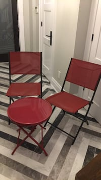 Two black metal framed red padded chairs - negotiable 575 km