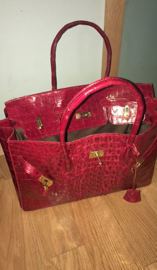 Red leather tote bag and wallet