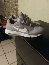 pair of gray Nike running shoes Chattanooga, 37416