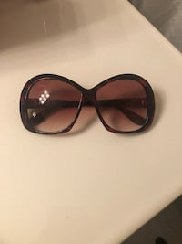black framed sunglasses with black lens Las Vegas, 89178