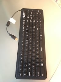 Black logitech wireless computer keyboard 28 km