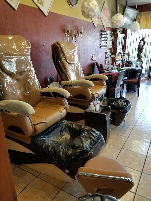 two beige leather massage chairs