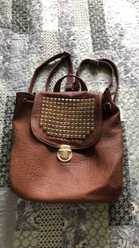 Brown backpack with studded flap North Grenville, K0G