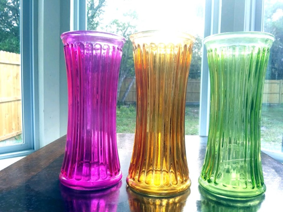 Photo Set of colored glass flower vases