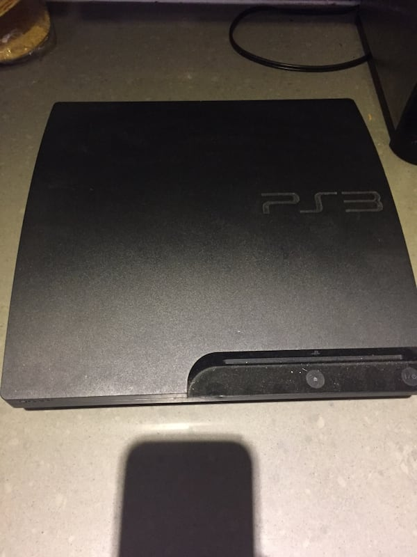 PS3 with 5 games 907a6417-9ddb-4d28-b740-9026c7c67aa8
