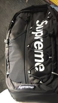 Black and white supremes backpack