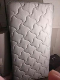 white quilted bed mattress