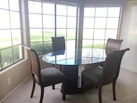 Round glass top table with four chairs dining set Anaheim, 92807