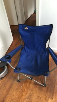 Blue and black camping chair 57 km