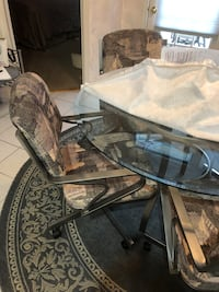 """48 """" round glass table and 4 swivel chairs"""