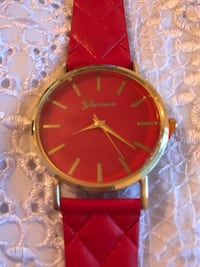 Round silver analog watch with red leather strap Los Angeles, 90023