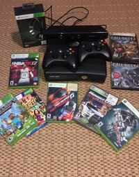black Xbox 360 console with controllers and game cases Paauilo, 96727