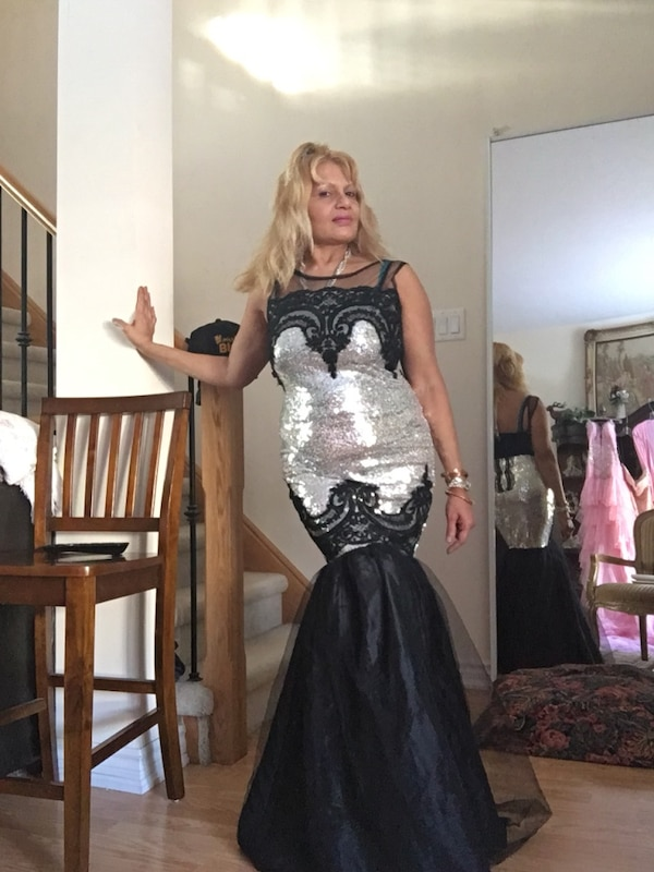 Women's black and silver sequin illusion neckline sleeveless mermaid gown,comes with silver purse and hair comb