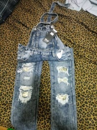 (Thrill) ripped skinny jean overalls.  Milwaukee, 53209