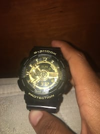 G shock watch (black and gold)