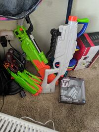 Nerf guns with some accessories.