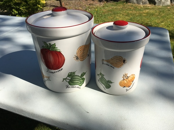 Two white ceramic canisters