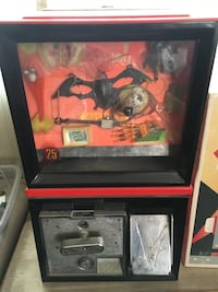 Vintage spooky gum ball machine with front display of Halloween items.  Have key. Great shape   Fort Wayne, 46815