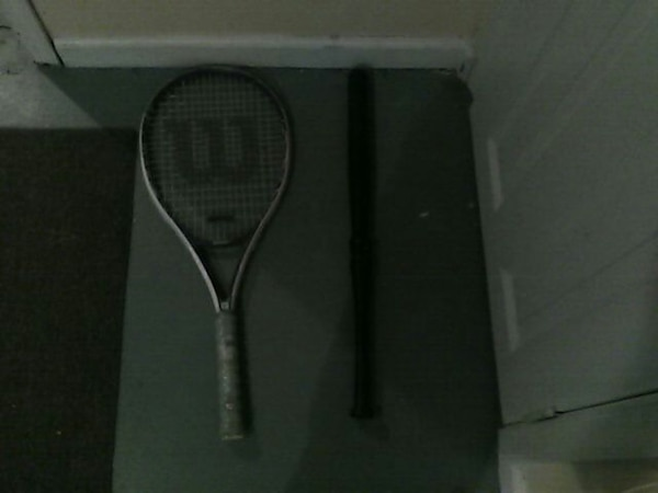 black and gray Wilson tennis racket e6ef6477-52f3-4385-9d49-7ef0095c4d50