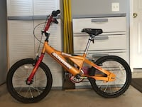 Orange and black bmx bike