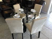 white and black wooden dining table set Houston, 77041