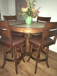 round brown wooden table with four chairs dining set Alum Creek, 25003