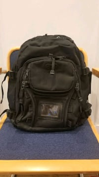 Black backpack, various compartments, outdoor, travel, hiking, school,