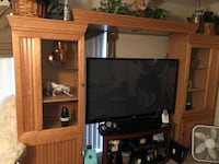 Brown wooden tv wall unit both items with flat screen television Orlando, 32811