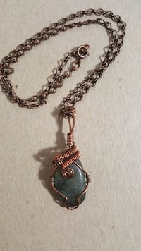 gray and brass pendant necklace