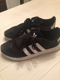 pair of black-and-white Adidas sneakers Montréal, H8T 3B5