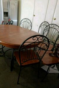 oval brown wooden table with 6 chairs dining se Oxnard, 93035