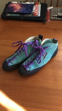 Pair of blue-and-black scarpa rock climbing shoes