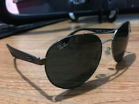 black Ray-Ban aviator sunglasses