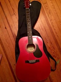 Red and black acoustic guitar Windsor township, 17366