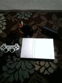 PS 2 with 7 video games  Pooler