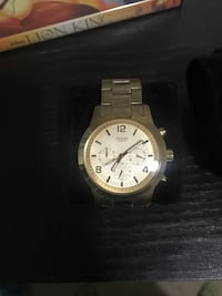 round white chronograph watch with silver link bracelet Calgary, T2Y
