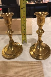 Paired brass candlestick holders  Calgary, T2V 3A6