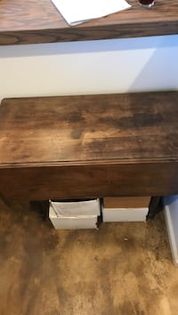 Square brown antique wooden table