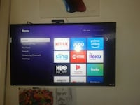 black flat screen TV with remote Perris, 92571