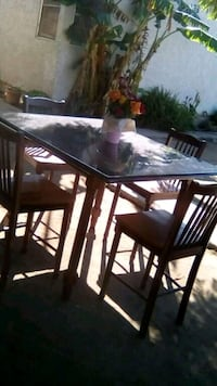 rectangular brown wooden table with four chairs dining set Oxnard