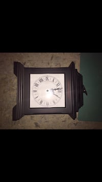 black wooden framed analog clock London, N6P 1E5