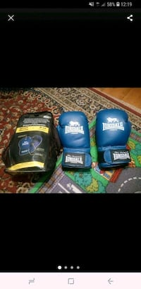 two blue  boxing gloves Greater London, NW11 7ES