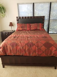 brown wooden bed frame with red bed sheet Alexandria