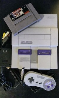 Nintendo Super NES set w/ all cables, controller, hockey game