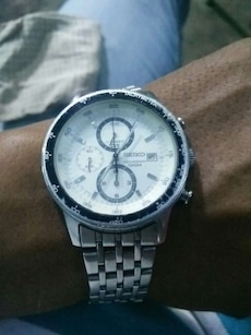 round white face Seiko chronograph watch with silver link bracelet